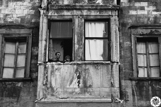 A man and a girl looking out the window in Kuledibi, Istanbul