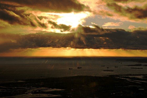 Sun setting over the Pacific - sun rays glaring through a winter weather storm