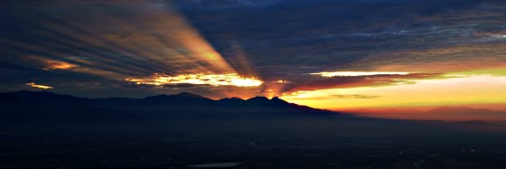 Sunrise over Los Angeles - rays peeking between Mt. Baldy & the clouds
