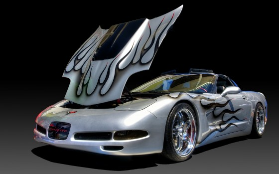 Heavily modified Corvette on a digital gradient background