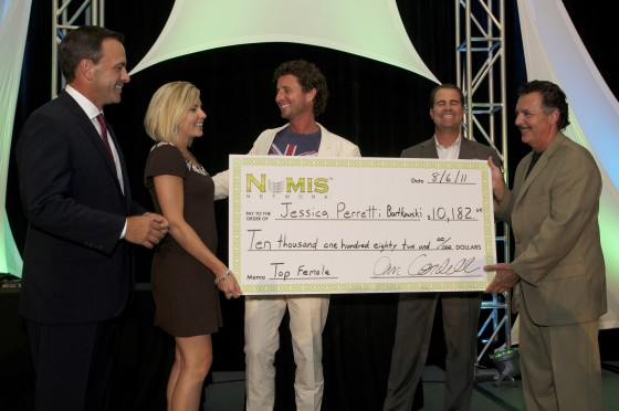 Receiving a giant check at an annual conference.