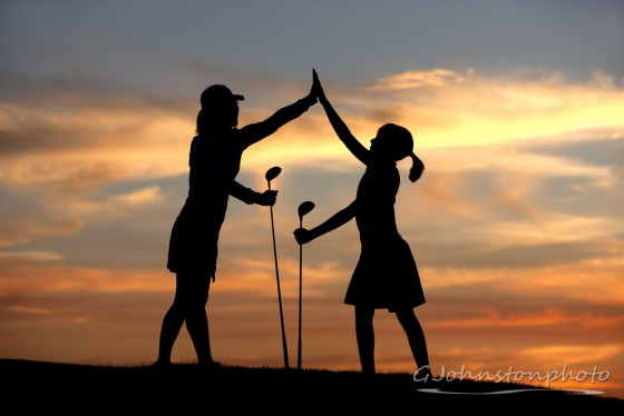 High five at sunset on the golf course.